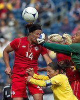 On corner kick, Brazilian player Barbara (12) punches out. Canadian forward Melissa Tancredi (14). In an international friendly, Canada defeated Brasil, 2-1, at Gillette Stadium on March 24, 2012.