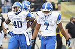 UK linebacker Avery Williamson and safety Daron Blaylock walk off the field during the second half of the University of Kentucky vs. Vanderbilt University football game at Vanderbilt Stadium in Nashville, Tenn., on Saturday, November 16, 2013. Vanderbilt won 22-6. Photo by Tessa Lighty | Staff