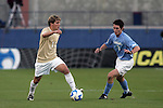 12 December 2008: Jamie Franks (11) of Wake Forest attempts to move the ball past Zach Loyd (3) of North Carolina.  The Wake Forest University Demon Deacons were defeated by the University of North Carolina Tar Heels 0-1 at Pizza Hut Park in Frisco, TX in an NCAA Division I Men's College Cup semifinal game.