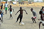 Displaced children play football in Agok, a town in the contested Abyei region where tens of thousands of people fled in 2011 after an attack by soldiers and militias from the northern Republic of Sudan on most parts of Abyei. Although the 2005 Comprehensive Peace Agreement called for residents of Abyei--which sits on the border between Sudan and South Sudan--to hold a referendum on whether they wanted to align with the north or the newly independent South Sudan, the government in Khartoum and northern-backed Misseriya nomads, excluded from voting as they only live part of the year in Abyei, blocked the vote and attacked the majority Dinka Ngok population. The African Union has proposed a new peace plan, including a referendum to be held in October 2013, but it has been rejected by the Misseriya and Khartoum.