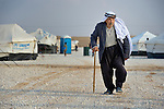 A man walks through the Zaatari Refugee Camp, located near Mafraq, Jordan. Opened in July, 2012, the camp holds upwards of 50,000 refugees from the civil war inside Syria. International Orthodox Christian Charities and other members of the ACT Alliance are active in the camp providing essential items and services.