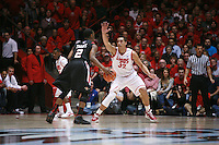 18 January 2012:  San Diego State Xavier Thames controls the ball on the perimeter against New Mexico Lobo#32 Drew Gordon. Aztec #2 San Diego State Aztecs defeated the New Mexico Lobos Lobos 75 - 70 at The Pit in Albuquerque, NM.