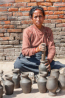Bhaktapur, Nepal.  Female Potter at Work in Potters' Square.