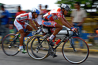 (Left to right) Freddy Paredes (team Bono Trecolli) and Jackson Rodriguez (team Tachira Lottery) compete in stage seven of the annual Vuelta al Tachira cycling race in El Vigia, Venezuela on Friday, Jan. 11, 2008. Local and international teams will ride over 1580 kilometers and climb a 1500 meter altitude differential throughout the competition. The grueling, 13-stage race through the Andes mountains is hailed as the premier cycling event in South America.