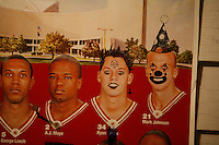 An Indiana University basketball team calendar hang defaced at a house where the punk band Party Garbage was performing in Bloomington, Indiana.