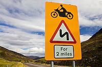Roadsign warning of dangerous bends in Glenshee, Scotland