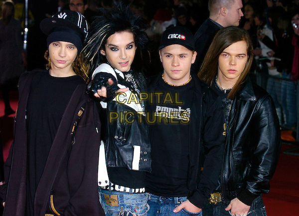 TOKIO HOTEL.Arrivals at World Music Awards 2006, Earls Court, London, UK..November 15th, 2006.half length Bill Kaulitz Tom Gustav Schafer Georg Listing black leather jacket pointing Tokyo.CAP/CAN.©Can Nguyen/Capital Pictures