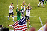 The USA's (left to right ) Joe Carona, Tim Howard, Stuart Holden and Geoff Cameron salute USA fans after  the USA Men's National Team's World Cup Qualifier against Panama at Century Link Field in Seattle, WA on June 11, 2013.
