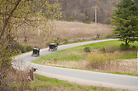 A group of Amish horse-drawn carriages are seen near a river in Wisconsin's Driftless Area near Viroqua.