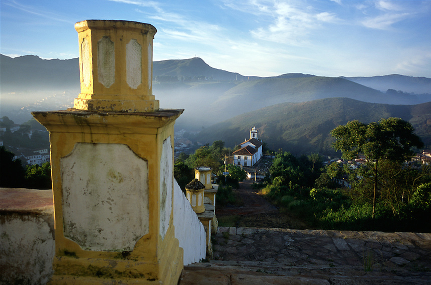One of 13 baroque masterpiece churches sits in the small city of Ouro Preto in Brazil's interior as the as morning fog lifts.