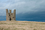 Lilburn Tower, part of the spectacular ruins of Dunstanburgh Castle, on a headland just north from the village of Craster. Northumberland, UK