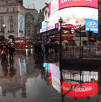 Piccadilly Circus at dusk beneath a rainy day, London, UK. Picture by Manuel Cohen