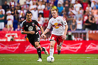 Dax McCarty (11) of the New York Red Bulls is marked by Hamdi Salihi (9) of DC United. The New York Red Bulls defeated DC United 3-2 during a Major League Soccer (MLS) match at Red Bull Arena in Harrison, NJ, on June 24, 2012.
