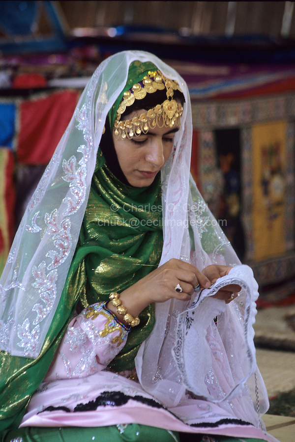 Sumail, Oman, Arabian Peninsula, Middle East - Omani Woman from Sumail Embroidering.