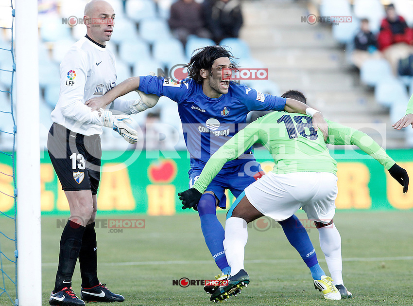 Getafe's Angel Lafita (c) and Malaga's Eliseu Pereira (r) and Willy Caballero during La Liga match.December 01,2012. (ALTERPHOTOS/Acero) ©/NortePhoto