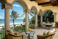 Polished yet relaxed outdoor living style for this classic lanai with ocean view