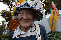 Michiko Saito 86 a life long anti nuclear campainer at an Anti nuclear protest by women outside the Ministry of Economy, Trade and Industry (METI) in Tokyo Japan. Friday November 4th 2011. The protest ran from October 27th to Noverber 5th. Originally started my mothers from Fukushima protesting about nuclear contamination from October 30th to November 5th the protest welcomed women and people from all over Japan.