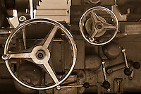 The adjustment wheel of a piece of overhauled industrial equipment.