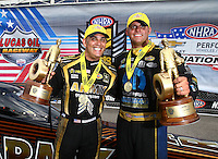 Sep 5, 2016; Clermont, IN, USA; NHRA top fuel driver Tony Schumacher (left) celebrates with funny car driver Matt Hagan after winning the US Nationals at Lucas Oil Raceway. Mandatory Credit: Mark J. Rebilas-USA TODAY Sports