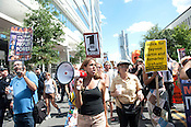 "Zaina Alsous leads the crowd in chants as the Wall Street South Protest made its way through downtown Charlotte on Sunday September 2nd 2012.  Protesters chanted things such as, ""Banks got bailed out, we got sold out."""