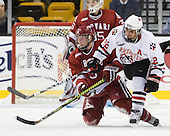 Alex Biega (Harvard - 3), Greg Costa (NU - 22) - The Northeastern University Huskies defeated the Harvard University Crimson 4-1 (EN) on Monday, February 8, 2010, at the TD Garden in Boston, Massachusetts, in the 2010 Beanpot consolation game.