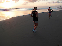 Evening exercise on the Kuta beach. Bali, Indonesia.<br />