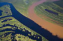 Bolivia, Beni Department, aerial view of the confluence of the Mamore´River (brown water) and the Itenez River (blue water) at the Brazilian border