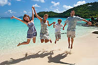 Family happy to be on vacation in the Virgin Islands<br /> Hawksnest Beach<br /> Virgin Islands National Park<br /> St. John, U.S. Virgin Islands