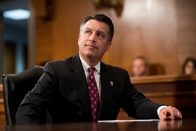 UNITED STATES - FEBRUARY 27: Gov. Brian Sandoval, R-Nev., listens as Gov. Terry McAuliffe, D-Va., speaks to the press in the Dirksen Senate Office Building on Monday, Feb. 27, 2017. (Photo By Bill Clark/CQ Roll Call)