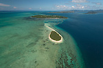 Aerial - small Katawaqa Island which is a turtle sanctuary and Kavewa Island Village.