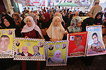 Palestinians take part in a protest demanding release the prisoners in Israeli jails, in front of Red cross office, in Gaza city, on August 31, 2015. Photo by Mohammed Asad