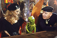 "Actress Carol Kane (L), Kermit the Frog (C) and Actor Telly Savalas (R) in a scene from ""The Muppet Movie,"" 1979. The musical comedy was the first theatrical film featuring the Muppets and included cameos by many famous actors. Photo by John G. Zimmerman."