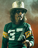 Alice Cooper does an encore at the Brown County Arena in Green Bay Wisconsin wearing a Green Bay Packers jersey. This was part of the Welcome To My Nightmare tour. Taken 3/25/1975
