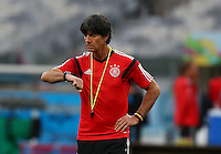 Germany coach Joachim Loew checks his watch during training ahead of tomorrow's semi final vs Brazil