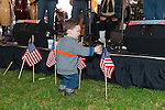 Fund raiser for firefighter Ray Pfeifer on Saturday, March 31, 2012, at East Meadow Firefighters Benevolent Hall, New York, USA. Rockland County toddler Brian Lavan (foreground) checked out American Flags while Celtic music band Tin Can Hooley, from Boston, played