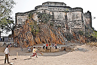 Boys playing cricket in front of ancient fort. Cricket is one of the most popular games in India. (Photo by Matt Considine - Images of Asia Collection)