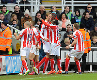 Peter Crouch of Stoke City celebrates scoring their first goal with team mates