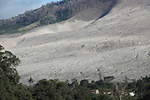 Pyroclastic flow deposits near houses, Sinabung Volcano, Indonesia