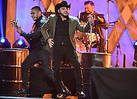 CORAL GABLES, FL - APRIL 30: Gerardo Ortiz performs at the 2015 Billboard Latin Music Awards presented bu State Farm on Telemundo at BankUnited Center on April 30, 2015 in Miami, Florida. Credit: MPI10 / MediaPunch