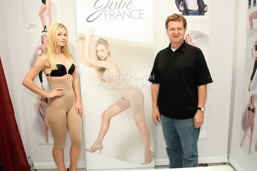 Model and Rodrigo Cano pose during the CURVENY Designer Lingerie & Swim show, at the Jacob Javits Convention Center, August 3, 2010.