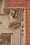A dragon carved into the corner of a window on a building in Krakow, Poland