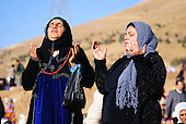 GOIZHA, IRAQ: Two Iraqi Kurdish women pray for rain...The current fall and winter have been extremely dry in northern Iraq.  A number of Islamic parties in the north of the country organized mass prayer gatherings to combat the coming drought...Photo by Sartep Osman/Metrography