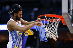 North Carolina Tar Heels guard Joel Berry II cuts the net down after they defeated the Kentucky Wildcats during the 2017 NCAA Men's Basketball Tournament South Regional Elite 8 at FedExForum in Memphis, TN on Friday March 24, 2017. Photo by Michael Reaves | Staff