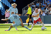 Red Bulls forward Luke Rodgers (9) goes around Sporting KC defender Aurelien Collin...Sporting Kansas City defeated New York Red Bulls 2-0 at LIVESTRONG Sporting Park, Kansas City, Kansas.