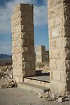 Ghost town of Rhyolite, Nevada<br /> <br /> Overbury Bank ruins pillars frame the old 8-room schoolhouse
