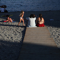 Tourists on Saint Vincent Beach, Collioure, France. Picture by Manuel Cohen.
