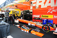 Jan. 17, 2012; Jupiter, FL, USA: Crew members work on the car of NHRA top fuel dragster driver Spencer Massey during testing at the PRO Winter Warmup at Palm Beach International Raceway. Mandatory Credit: Mark J. Rebilas-