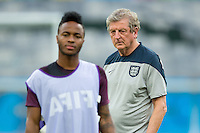 England manager Roy Hodgson watches Raheem Sterling