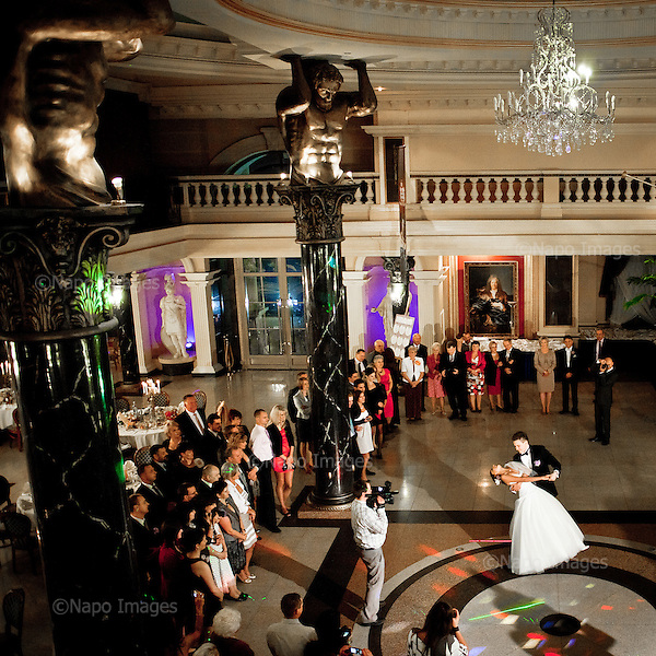 WARSAW, POLAND, NOVEMBER 2011:.Wedding party at Venecia Palace Hotel. It was built in 2008 by Polish businessman Waclaw Gozlinski, who concluded that clients, often watching American class B movies and soap operas, are now seeking for fancy, often kitchy interiors for their parties and gatherings..As Poles are getting richer, this place is now the most popular wedding party spot in Poland, which now needs to be booked over a year in advance..(Photo by Piotr Malecki / Napo Images)..Warszawa, Listopad 2011:.Wesele w hotelu Venecia Palace. Zbudowal go w 2008 roku biznesmen Waclaw Gozlinski, gdy zauwazyl, ze Polacy coraz czesciej preferuja kiczowate wesela w ociekajacych sztukateria wnetrzach jak w Las Vegas lub telewizyjnych operach mydlanych. Hotel jest ogromnym sukcesem, czesto trzeba go rezerwowac z ponad rocznym wyprzedzeniem..Fot: Piotr Malecki / Napo Images