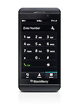 Blackberry Z10 smartphone with phone dial pad on its display. Black phone isolated on white background with clipping path